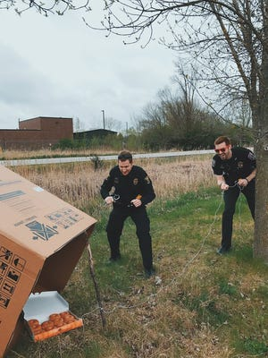 """Eric Snyder (left) of the Ames Police Department and Anthony Greiter of the Iowa State University Police Department set up a """"weed trap"""" on Thursday, April 20, 2017 in Ames. April 20 is known as """"420"""" — an informal holiday celebrating marijuana"""