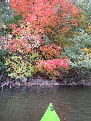 The fall colors are seen from a kayak on Lake Macbride.