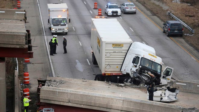 Work continued in the aftermath of the bridge collapse on Interstate 75 in Cincinnati on Jan. 20, 2015. Highway advocates are urging Congress to  approve more funding to repair roads and fix aging bridges.