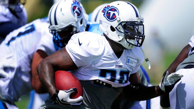Titans running back Shonn Greene races up the field during Monday's practice at Saint Thomas Sports Park.