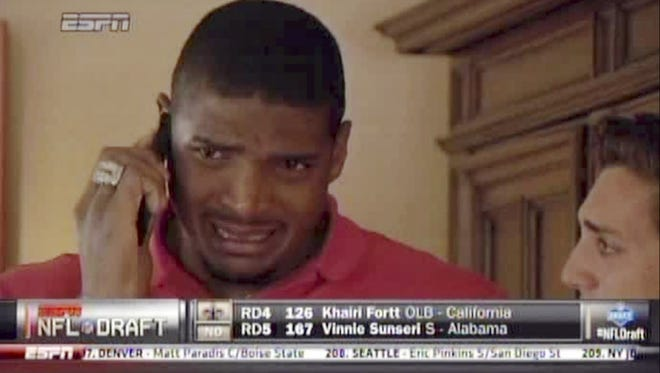 Video image of Michael Sam crying at an NFL draft party in San Diego on Saturday with his boyfriend, Vito Cammisano.
