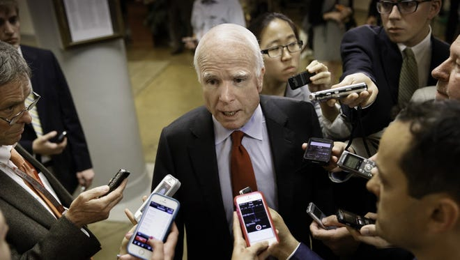 Senate Armed Services Committee member  John McCain, R-Ariz., speaks with reporters on Capitol Hill in Washington June 4.