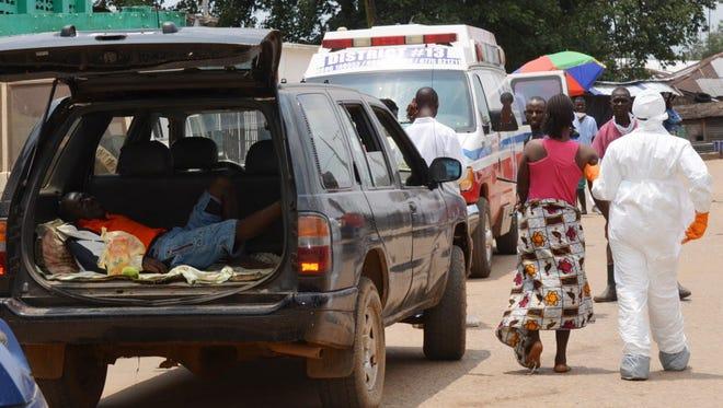 Ebola patients arrive at a hospital in Monrovia. Liberia, last week.