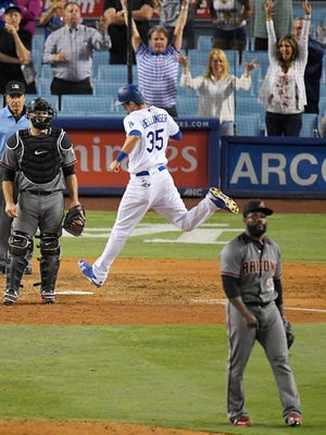 Los Angeles Dodgers' Cody Bellinger scores on a single by Corey Seager to tie the game against Fernando Rodney and the Diamondbacks on Thursday night.