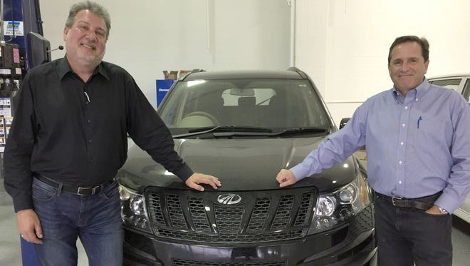 From left, Richard Haas, CEO of the Mahindra North American Technical Center and Richard Ansell, vice president of marketing at the Mahindra North America.