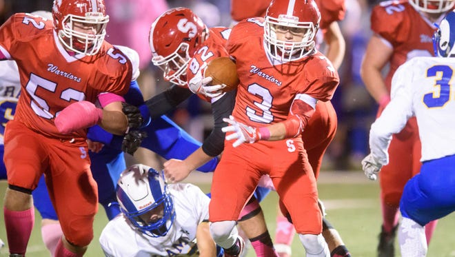 Susquehannock's Ben Trego (3) splits the Kennard-Dale defense in a YAIAA football game on Friday, Oct. 28, 2016. The Warriors won 51-0.