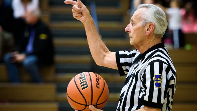 Enforcers of the game in danger? Officials are the overlooked cornerstone of high school sports, and their decreasing numbers are troublesome in some sports. Here, Don Middleton officiates a junior high girls' game at Eastern York Middle School as he neared retirement last year. Middleton officiated basketball and softball for more than 45 years.