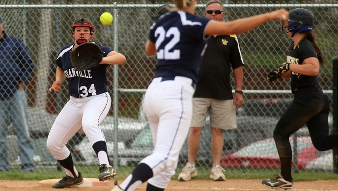 Granville's Sophia Ehlers, center, fields the ball to Megan Gummere keeping Watkins Memorial's Caitlyn Dobbs from landing on first Monday during the Blue Aces' 12-0 loss.