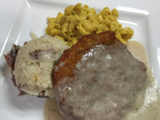 Country-fried seitan with mashed potatoes and mac and