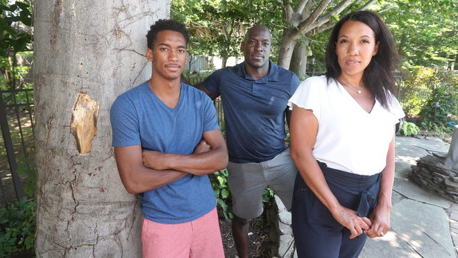 Myles Blackwood (left) with his parents, Marcus and Courtney Blackwood, at their home in Greece. Myles and his cousin were waiting to meet a trainer to play basketball at a Penfield school when a school official decided the two looked suspicious and called police.