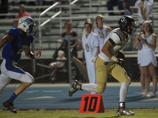 Mt. Juliet's Aiden Raines goes in for a touchdown as Lebanon was defeated 35-0 on Friday in Lebanon.