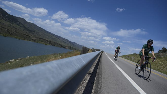 Cyclists ride around Horsetooth Reservoir in May.