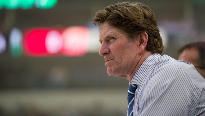 Detroit Red Wings coach Mike Babcock watches his team warm up prior to a game against the Dallas Stars.