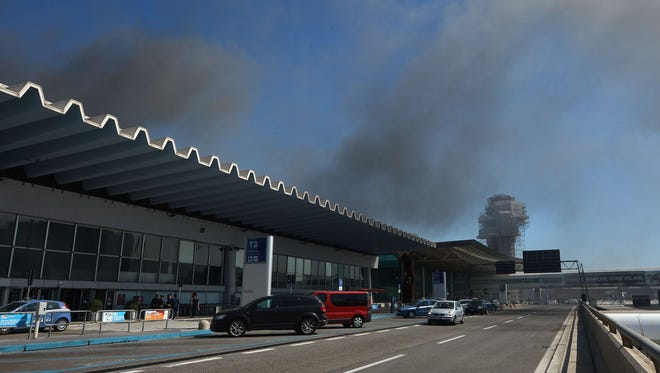 Smoke is seen over Rome's Fiumicino international airport where a fire broke out overnight on May 7, 2015.