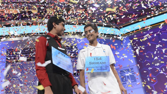 Ansun Sujoe and Sriram Hathwar celebrate being co-champions at the 2014 Scripps National Spelling Bee in National Harbor, Md.
