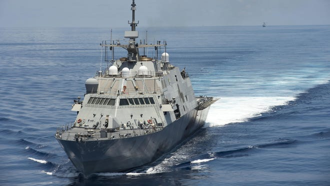 The USS Fort Worth conducts patrols in international waters of the South China Sea near the Spratly Islands in May as the People's Liberation Army-Navy guided-missile frigate Yancheng transits close behind.