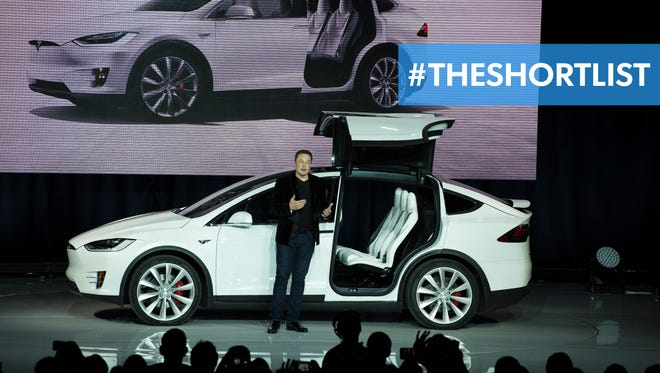 Tesla Motors CEO Elon Musk unveils the Model X at a launch event in Fremont, Calif., Sept. 29.