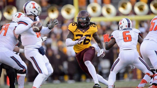 Minnesota redshirt senior De'Vondre Campbell chases down Illinois' quarterback in a game this season.
