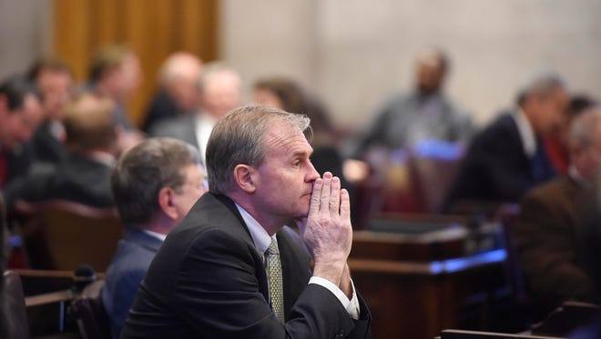 Rep. Bill Dunn sits in the House chambers after he withdrew the voucher bill Thursday at the Tennessee State Capitol in Nashville.