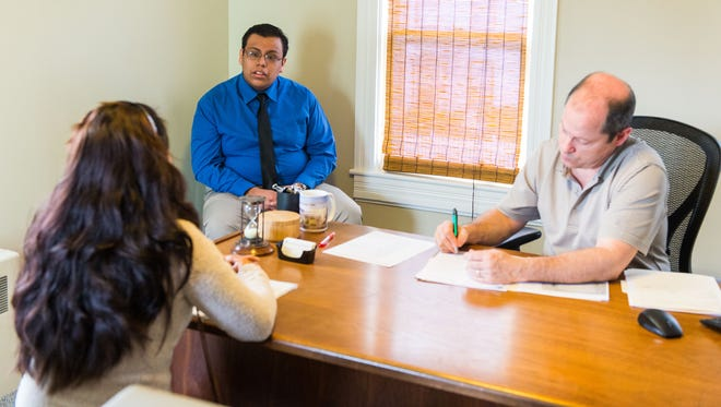 Billy Deleon-Velasquez, a Cape Henlopen senior, translates a conversation between a client and lawyer Ted Murphy on Monday, Feb. 22 at Murphy Law Firm in Georegtown.