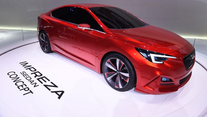 The Subaru Impreza, seen here as a concept vehicle, was top compact car, Consumer Reports says.