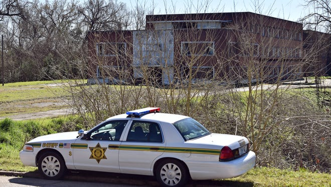Warren County sheriff's deputies check out Kuhn Hospital on Wednesday while searching for escaped inmate Rafael McCloud, 34, who is a suspect in a capital murder which took place at the abandoned hospital.