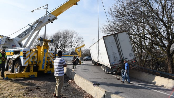 A tractor-trailer got caught on a concrete barrier at the Mid-Hudson bridge Tuesday morning as the driver attempted to turn onto the bridge. The ramp where the incident took place, which connects Route 9 to the bridge, was temporarily closed as tow trucks removed the tractor-trailer from the scene, according to City of Poughkeepsie Police. The tractor-trailer was the only vehicle involved in the incident. No injuries were reported, according to police.