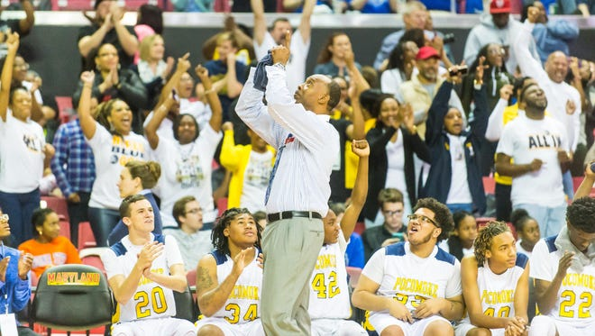 Pocomoke head coach Derrick Fooks points to the sky in the final moments against Lake Clifton in the MPSSAA 1A Finals at the Xfinity Center in College Park on Satuday, March 12.