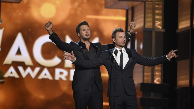 Co-hosts Luke Bryan, left, and Dierks Bentley open the show during the 51st Academy of Country Music Awards at the MGM Grand Garden Arena on Sunday April 3, 2016, in Las Vegas, NV.