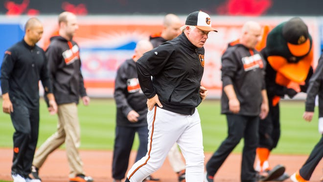 Oriole's manager Buck Showalter (26) heads to the dugout at Oriole Park at Camden Yards on Monday, April 4 in Baltimore.