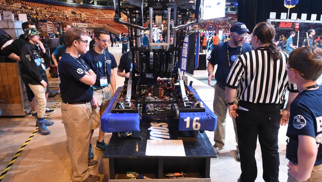 Immediately after being knocked out of the world championship Saturday, Bomb Squad members stopped to talk with a match referee about the design of their robot, displaying the gracious professionalism prized by FIRST, the organization that put on the robotic competition in the Edward Jones Dome in St. Louis over four days.