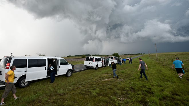 Storm chasers flock to dangerous storms to take pictures for excitement or profit