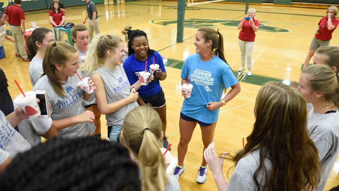 Pro beach volleyball player Brooke Sweat, who will represent the United States at this year's Rio Olympics, speaks to the Hume-Fogg volleyball team at Hillsboro High School on Monday.