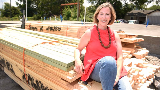 Megan Florentine sits in front of the foundation of her new home in the Treaty Oaks subdivision, expected to be finished in November. Treaty Oaks is located in the Nations, and its homes, starting at $259,000, are more affordable than many new single-family houses in the neighborhood.