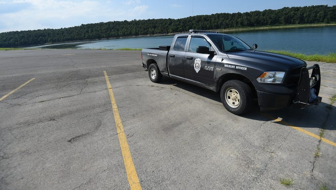 A wildlife officer's truck sits at the boat ramp in Gamaliel Park in the general area where the body of a 76-year-old Gamaliel man was found early Friday Morning.