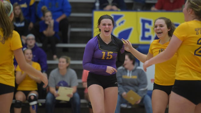 Hagerstown volleyball players celebrate during the volleyball sectional Saturday, Oct. 22, 2016 at Lincoln High School in Cambridge City.