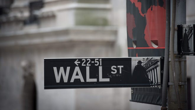 Wall street sign near the New York Stock Exchange in New York.