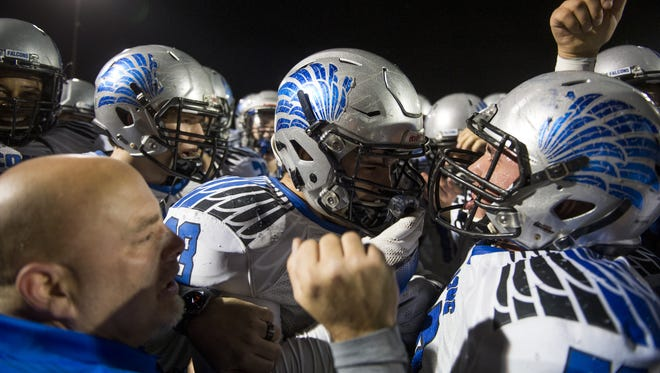 The Tucson Catalina Foothills football team celebrates its victory over Gilbert Higley in the state semifinals at Williams Field High School in Gilbert on Friday, Nov. 18, 2016.