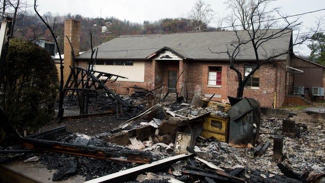 A destroyed building directly behind Pi Beta Phi Elementary, Tuesday, Dec. 6, 2016, in Gatlinburg, Tenn.