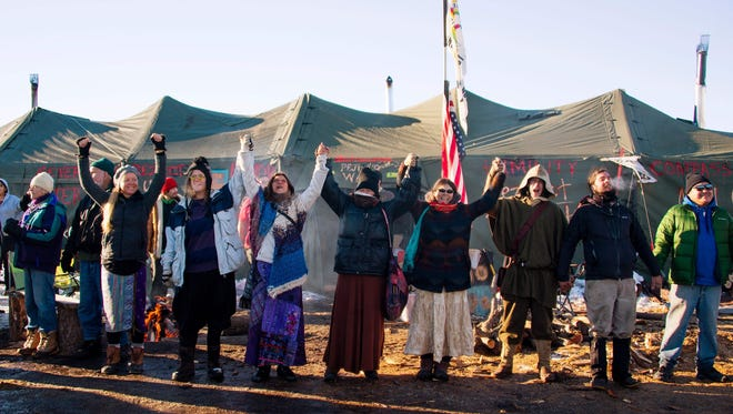 Activists celebrate at Oceti Sakowin Camp on the edge of the Standing Rock Sioux Reservation.