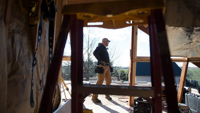 Michael Baker looks over progress on a job site in Hanover on Wednesday, Jan. 4, 2017. In addition to his contracting work, Baker is a first lieutenant in the Army Reserves and is scheduled to deploy to Kuwait this spring.