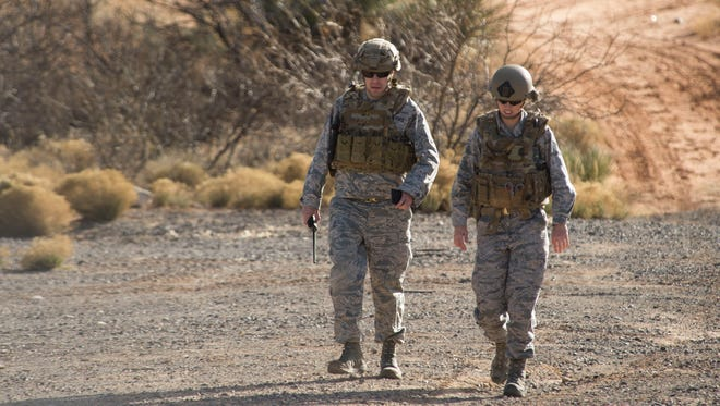 Master Sgt. Rob Shuman, the 49th Civil Engineer Squadron explosive ordnance disposal quality assurance manager, and Staff Sgt. Jacque Risley, a 49th Civil Engineer Squadron EOD technician, walk back to the safe area after investigating a potential unexploded ordnance, Jan. 6, 2017 at Holloman Air Force Base, N.M. Holloman's EOD unit was alerted by the U.S. Border Patrol about the potential UXO.