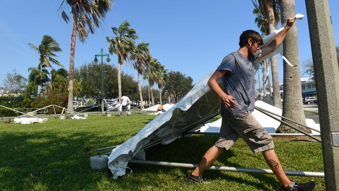 Dominick Caffaro, with Superior Event Rentals, helps construct tents Thursday, Feb. 16, 2017, for vendors for the Florida Craft Brew & Wingfest at Royal Palm Pointe in Vero Beach. The festival is in its sixth year and will run from 11:30 a.m. to 4 p.m. Saturday, Feb. 18, and will feature about 150 beers to sample.