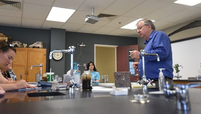 Students identify rock types in David Lincoln's lab (right) on Tuesday at Arkansas State University-Mountain Home. The college was recently approved to offer science courses, among others, at lower rates to high school students.