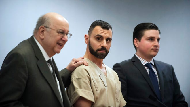 Richard Dabate, center, appears with attorneys Hubie Santos, left, and Trent LaLima, right, while being arraigned, in Rockville Superior Court.
