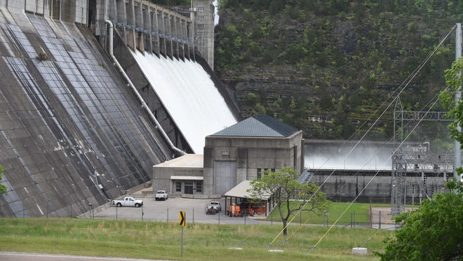 Water pours out of the 12 spillway gates on the Norfork Dam in this file photo. The U.S. Army Corps of Engineers plans to open the spillways on Monday to reduce the lake level.
