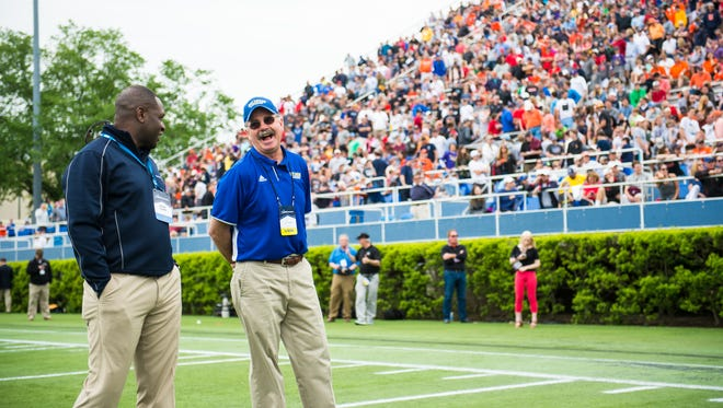 Retiring Delaware lacrosse coach Bob Shillinglaw, joined by NCAA rep Anthony Holman, is honored at the NCAA quarterfinals Sunday at Delaware Stadium.