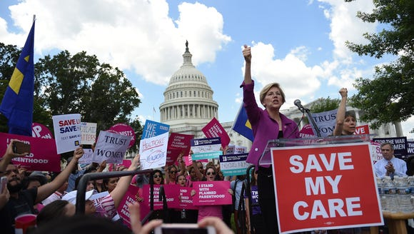 Sen. Elizabeth Warren, D-Mass., speaks at a rally to