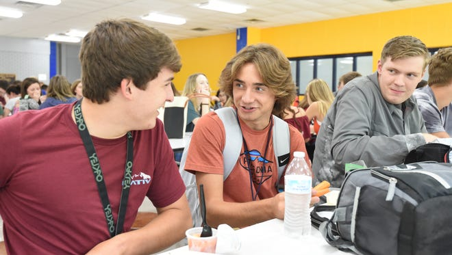 Jager DeAlejandro (left), Ewan Platt (middle) and Michael Schraeder (right) chat at lunch Tuesday afternoon at the Mountain Home High School cafeteria. Tuesday marked the first day of school for the Mountain Home School District.