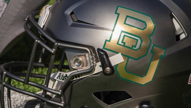 A detailed view of a Baylor Bears helmet before the game between the Bears and the West Virginia Mountaineers at McLane Stadium. The Bears defeat the Mountaineers 62-38.
